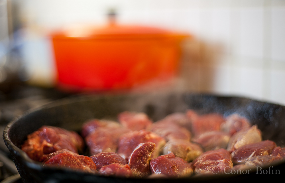 The venison chunks being browned. Not a bad photo despite the pressure.