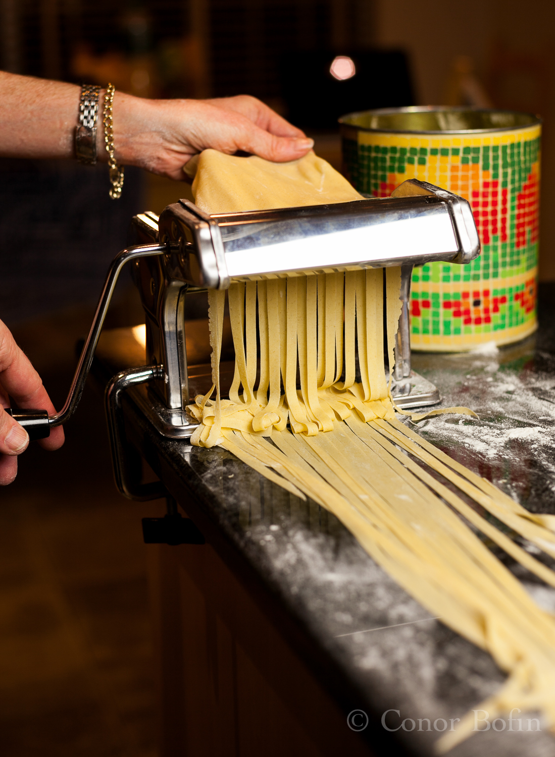 Yes, that's the Wife's hand feeding the pasta into the machine.