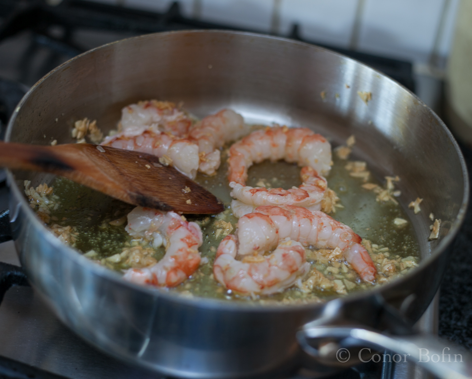 This cooks the prawns and adds lots of garlic flavour to them.